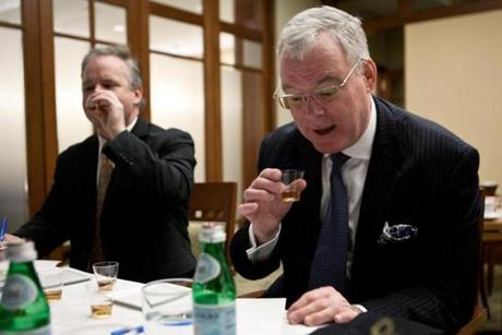 Jim Carmody (right), the Seaport Hotel's vice president and general manager, reacted to the unique taste of a bourbon sample.